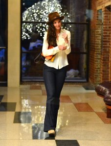 Katie homes gets it right...try this 60's man hat with a shirt and boyfriend jeans. Can also try with ribbed jeans