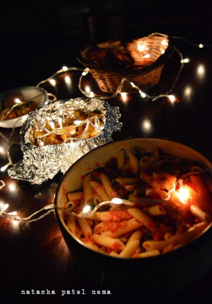 Arrabiatta pasta, baked potatoes, garlic bread and mohanthal sweet..