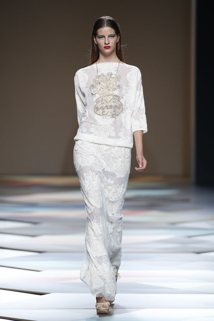 Lace all white long skirt and top, a sure bet for a summer day look.