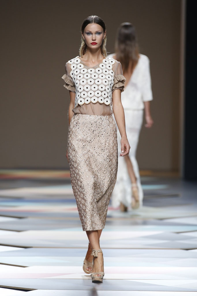 Layered peasant top with textured skirt. Since there is enough going on  with the patterns , the color selected is basic and the silhouette is also very basic