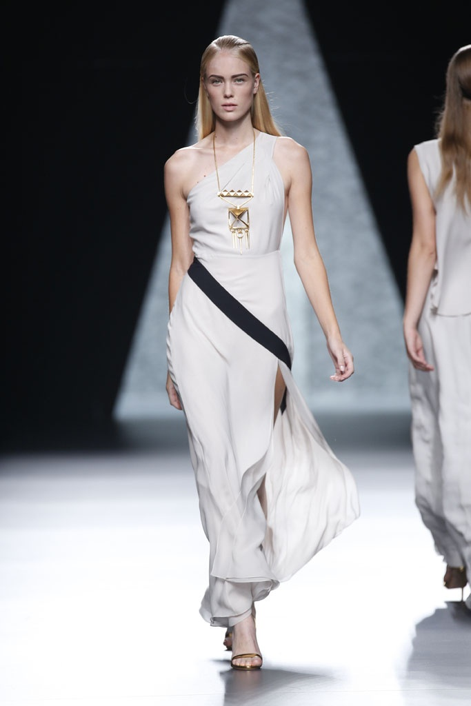 White dress with a black stripe at the right place. This dress would suit with someone having a pair shape figure. The geometric necklace completes the look.