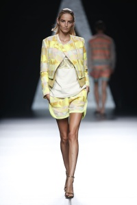 Geometric patterned jacket in a bright yellow, it would go very well with Lenin pants or a denim