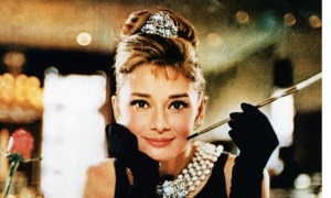 Audrey hepburn's famous hairstyle in breakfast at Tiffany, with her hair pinned up on top of her head into a beehive