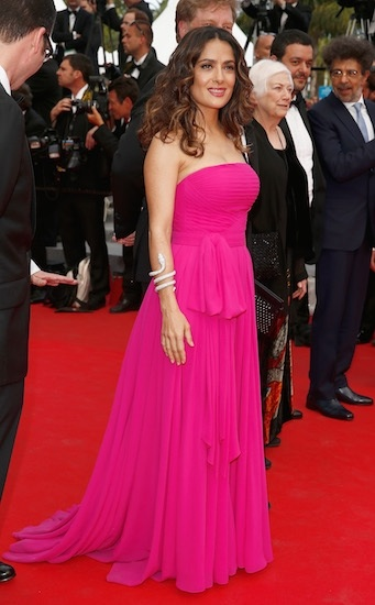 Salma Hayek gets it right in this st. Laurent dress. When color is as bright as this pink, keep the rest of it simple. Simple make up, simple hair, just one accessory. Even the dress doesn't have any embroidery.