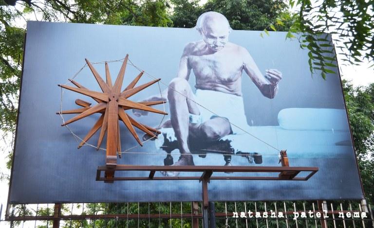 Bapu spinning his famous charkha and making khadi