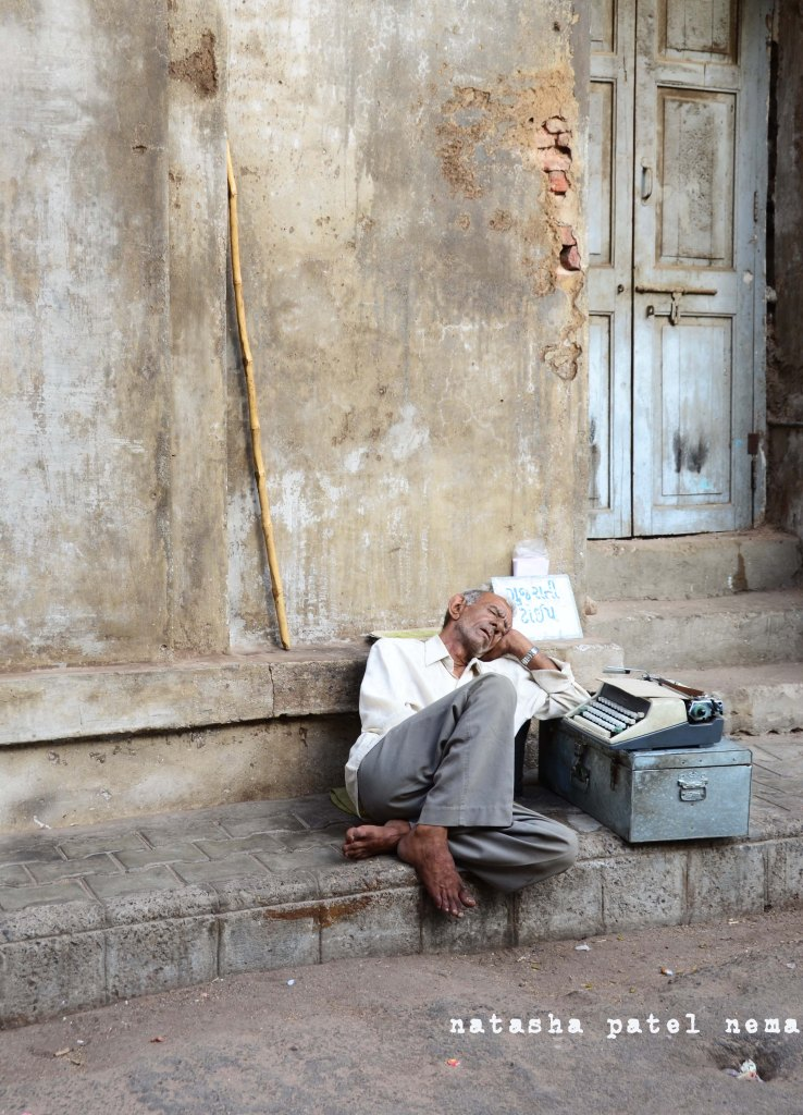 This typist taking his afternoon nap outside the high court in the city of Ahmedabad