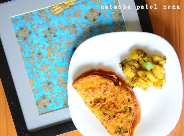 Indori graam flour pulla with Gujarati potato sabji, I took this picture on our wedding invitation :-)