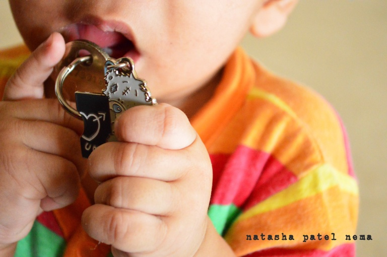 Our baby playing with our new house keys...the key chain put was a 2 part key chain which Sid had given one to me and kept one for him self when we parted from our M.B.A...that time I never knew we would be together for so long to use it for our house keys...